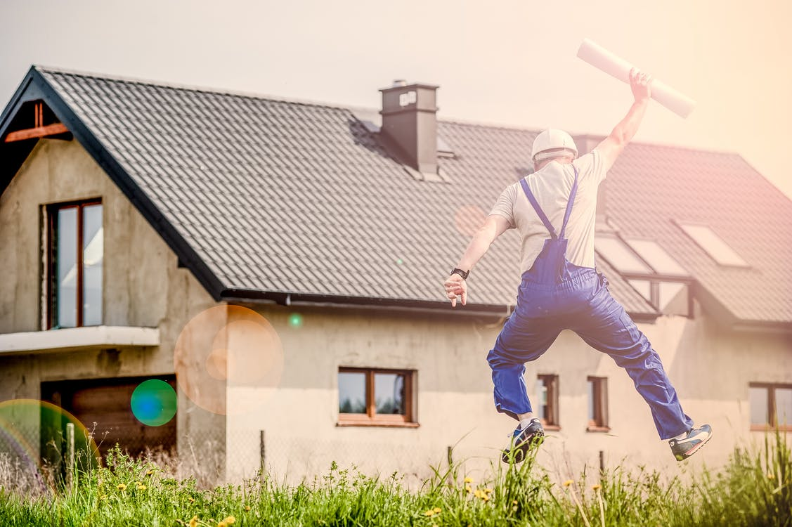 Small Business Owner Jumping For Joy